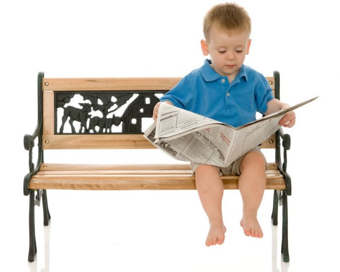 cute-little-boy-reading-newspaper-wallpaper